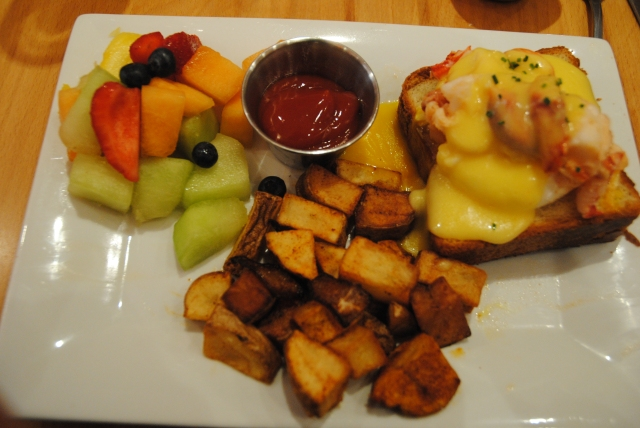 Eggs Benedict w/ home fries and fruit, on amazing bread - Click to see more of the Menu at Claw